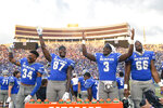 Memphis players Eric Rivers (34), Jeremy Tate Jr. (87), Keith Brown Jr. (3) and Makylan Pounders celebrate in the closing moments of an NCAA college football game against Mississippi State, Saturday, Sept. 18, 2021, in Memphis, Tenn. (AP Photo/John Amis)