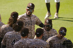San Diego Padres shortstop Fernando Tatis Jr, top left, celebrates with teammates after they defeated the Los Angeles Dodgers in a baseball game Sunday, April 18, 2021, in San Diego. (AP Photo/Gregory Bull)