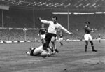 FILE - In this Oct. 23, 1965 file photo, England inside-right Jimmy Greaves vies for the ball against Yugoslav goalkeeper Milutin Soskic during the second half of the Football Association football match between England and the Rest of the World at Wembley Stadium, London. Jimmy Greaves, one of England's greatest goal-scorers who was prolific for Tottenham, Chelsea and AC Milan has died. He was 81. With 266 goals in 379 appearances, Greaves was the all-time record scorer for Tottenham, which announced his death on Sunday, Sept. 19, 2021. (AP Photo/Robert Rider-Rider, File)