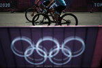Riders train for the mountain bike cycling race, at the 2020 Summer Olympics, Friday, July 23, 2021, in Izu, Japan. (AP Photo/Thibault Camus)