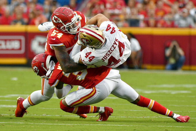 San Francisco 49ers fullback Kyle Juszczyk (44) is tackled by Kansas City Chiefs linebacker Damien Wilson (54) and cornerback Herb Miller, bottom, during the first half of an NFL preseason football game in Kansas City, Mo., Saturday, Aug. 24, 2019. (AP Photo/Ed Zurga)