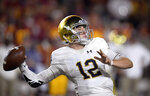 Notre Dame quarterback Ian Book throws a pass during the first half of the team's NCAA college football game against Southern California on Saturday, Nov. 24, 2018, in Los Angeles. (AP Photo/Mark J. Terrill)