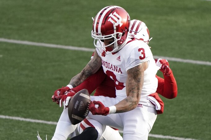 Wisconsin cornerback Donte Burton breaks up a pass intended for Indiana wide receiver Ty Fryfogle during the first half of an NCAA college football game Saturday, Dec. 5, 2020, in Madison, Wis. (AP Photo/Morry Gash)