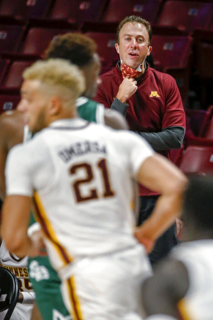 Minnesota coach Richard Pitino watches the team play Green Bay Phoenix during an NCAA college basketball game Wednesday, Nov. 25, 2020, in Minneapolis. Minnesota won 99-69. (AP Photo/Bruce Kluckhohn)