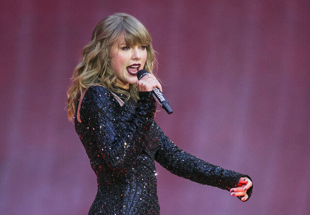 "FILE - In this June 22, 2018, file photo, singer Taylor Swift performs on stage in concert at Wembley Stadium in London. ABC will air the one-hour concert special ""Taylor Swift City of Lover Concert"" at 10 p.m. EDT. It was filmed last September at L'Olympia Theater in Paris.  (Photo by Joel C Ryan/Invision/AP, File)"