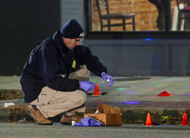 A Huntington police officer investigates the scene of a shooting in Huntington, W.Va., Wednesday, Jan. 1, 2020. Police in West Virginia say several people were injured after a shooting at a bar in Huntington early New Year's Day. Huntington's interim police chief says the shooting happened Wednesday at the Kulture Hookah Bar. (Lori Wolfe/The Herald-Dispatch via AP)