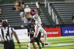 New Mexico State wide receiver Andre Bodison (11) makes a catch over Hawaii defensive back Quentin Frazier (19) during the first half of an NCAA college football game Saturday, Oct. 23, 2021, in Honolulu. (AP Photo/Marco Garcia)