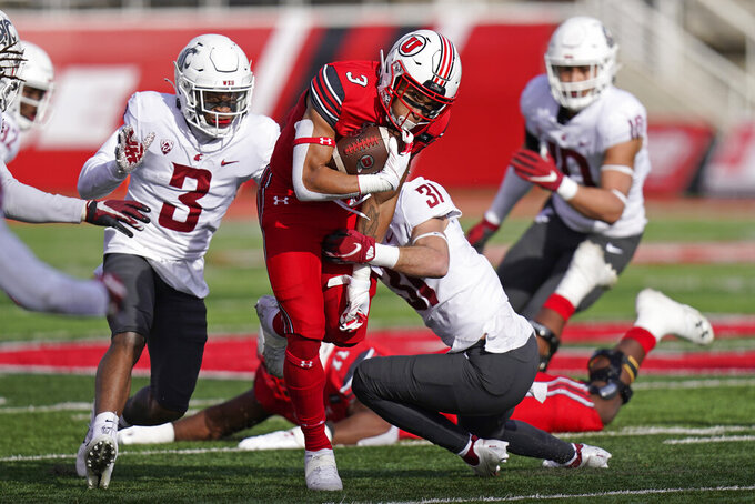 Washington State defensive back Hunter Escorcia (31) tackles Utah running back Micah Bernard (3) during the first half of an NCAA college football game Saturday, Dec. 19, 2020, in Salt Lake City. (AP Photo/Rick Bowmer)