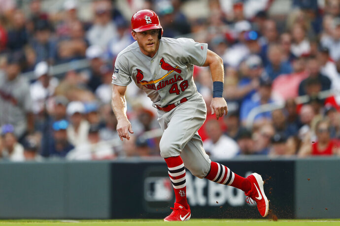 FILE - In this Oct. 3, 2019, file photo, St. Louis Cardinals' Harrison Bader (48) runs to second base during the fifth inning during Game 1 of a best-of-five National League Division Series against the Atlanta Braves in Atlanta. Bader is confident he will be the starting center fielder for the Cardinals when the season begins. (AP Photo/John Bazemore, File)