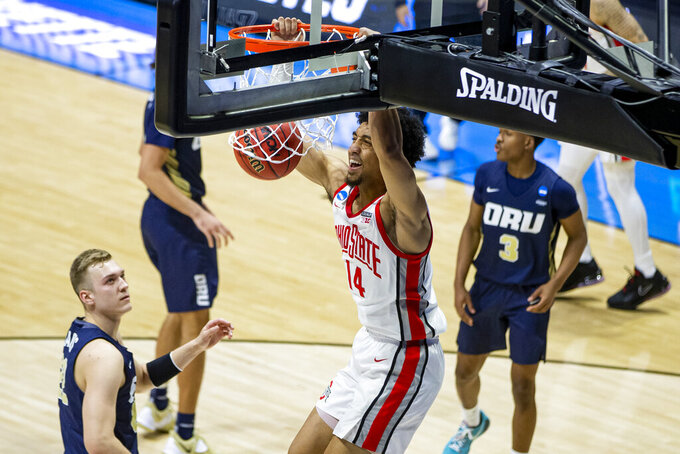 Ohio State's Justice Sueing (14) dunks over Oral Roberts' Francis Lacis, left, during the first half of a First Round game in the NCAA men's college basketball tournament, Friday, March 19, 2021, at Mackey Arena in West Lafayette, Ind. (AP Photo/Robert Franklin)