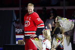 Carolina Hurricanes Jordan Staal (11) looks towards his family during a pre-game ceremony recognizing his 1000 career game prior to the first period of an NHL hockey game between the Carolina Hurricanes and the Detroit Red Wings in Raleigh, N.C., Monday, April 12, 2021. (AP Photo/Karl B DeBlaker)
