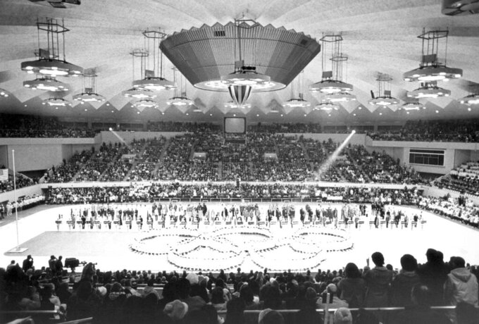 FILE - In this Feb. 13, 1972, file photo, Olympic rings in the center of the Makomanai ice arena is seen during the closing ceremony of the Winter Olympics, in Sapporo, Japan. Yasuhiro Yamashita, the president of the Japanese Olympic Committee, said Tuesday, July 14, 2020, that if Tokyo can pull off next year's Summer Olympics, then the Japanese city of Sapporo could be in good standing with a bid to hold the 2030 Winter Olympics.  (AP Photo)