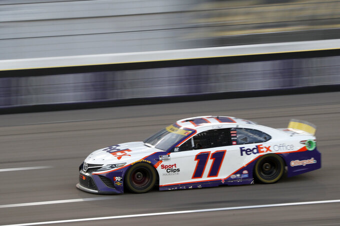 NASCAR Cup Series driver Denny Hamlin (11) races during a NASCAR Cup Series auto race at the Las Vegas Motor Speedway, Sunday, Sept. 26, 2021, in Las Vegas. Hamlin went on to win the race. (AP Photo/Steve Marcus)