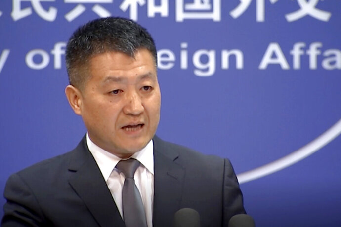 CORRECTS NAME OF SPOKESMAN - In this image from video, Chinese Foreign Ministry spokesman Lu Kang speaks during a media briefing which he commented on investigations into Chinese-Australian writer Yang Hengjun in Beijing Thursday, July 18, 2019. Yang who has been detained in Beijing since January was charged on Thursday and moved to a different detention center in the Chinese capital, his lawyer said. (AP Photo)