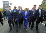 Delegates, from left, U.S. Congressman Brendan Boyle, Irish Education Minister Joe McHugh, U.S. Congressman Richard Neal and US House of Representatives speaker Nancy Pelosi, cross the Irish border from Northern Ireland into the Republic of Ireland, at Bridgened in Co Donegal, Thursday April 18, 2019.  Pelosi and other members of the U.S. delegation made the symbolic border crossing, that is the contentious Brexit border, between North and southern Ireland Thursday, as part of her four-day visit to Ireland and Northern Ireland. (Niall Carson/PA via AP)