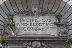 FILE - In this April 16, 2020, file photo, a Pacific Gas & Electric sign is displayed on the exterior of a PG&E building in San Francisco. PG&E's chief financial officer, Jason Wells, is expected to face questions Thursday, May 28 about the company's plan to nearly double its debt to almost $40 billion to finance its payments to wildfire victims, insurers and government agencies in the second day of the company's bankruptcy trial. Meanwhile, the Public Utilities Commission will vote on the bankruptcy plan. (AP Photo/Jeff Chiu, File)