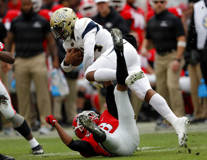 Georgia Tech's James Graham (4) tries to get past Georgia defensive back Tyson Campbell (3) during the second half of an NCAA college football game Saturday, Nov. 24, 2018, in Athens, Ga. Georgia won 45-21. (AP Photo/John Bazemore)