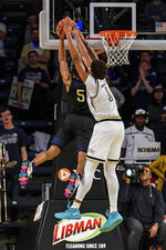 Georgia Tech forward James Banks III (1) blocks a shot by Pittsburgh guard Au'Diese Toney (5) during the second half of an NCAA college basketball game Wednesday, Feb. 20, 2019, in Atlanta. Georgia Tech won 73-65. (AP Photo/Danny Karnik)