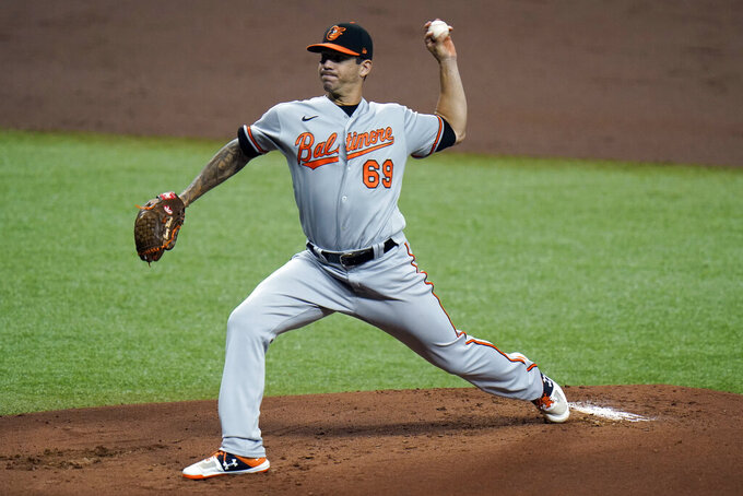 Baltimore Orioles starting pitcher Tommy Milone (69) delivers to the Tampa Bay Rays during the first inning of a baseball game Tuesday, Aug. 25, 2020, in St. Petersburg, Fla. (AP Photo/Chris O'Meara)