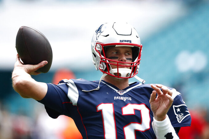 New England Patriots quarterback Tom Brady (12) warms up before an NFL football game against the Miami Dolphins, Sunday, Sept. 15, 2019, in Miami Gardens, Fla. (AP Photo/Brynn Anderson)