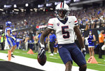 Arizona wide receiver BJ Casteel reacts after scoring a touchdown against BYU during the second half of an NCAA college football game Saturday, Sept. 4, 2021, in Las Vegas. (AP Photo/David Becker)