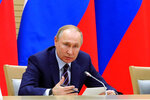 Russian President Vladimir Putin speaks as he chairs a meeting on drafting constitutional changes at the Novo-Ogaryovo residence outside Moscow, Russia, Thursday, Jan. 16, 2020. Putin proposed a set of constitutional amendments that could keep him in power well past the end of his term in 2024.(Mikhail Klimentyev, Sputnik, Kremlin Pool Photo via AP)