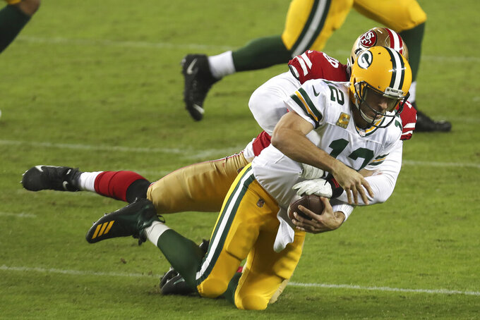 Green Bay Packers quarterback Aaron Rodgers (12) is sacked by San Francisco 49ers defensive lineman Jordan Willis during the first half of an NFL football game in Santa Clara, Calif., Thursday, Nov. 5, 2020. (AP Photo/Jed Jacobsohn)