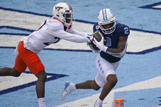 North Carolina wide receiver Dyami Brown (2) scores a touchdown as Virginia Tech defensive back Armani Chatman (27) chases during the first half of an NCAA college football game in Chapel Hill, N.C., Saturday, Oct. 10, 2020. (AP Photo/Gerry Broome)