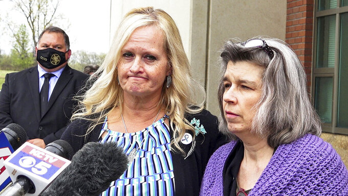 Jamie Runions, left, and Rhonda Beckford address the media Friday, April 16, 2021, at the Cass County Justice Center in Harrisonville, Mo., after the sentencing hearing for Kylr Yust, who was convicted on the day before. The Cass County jury recommended that Yust, 32, serve life in prison for second-degree murder in the death of Jessica Runions, 21, of Raymore, and 15 years in prison for voluntary manslaughter in the killing of 17-year-old Kara Kopetsky, of Belton. (Jill Toyoshiba/The Kansas City Star via AP)