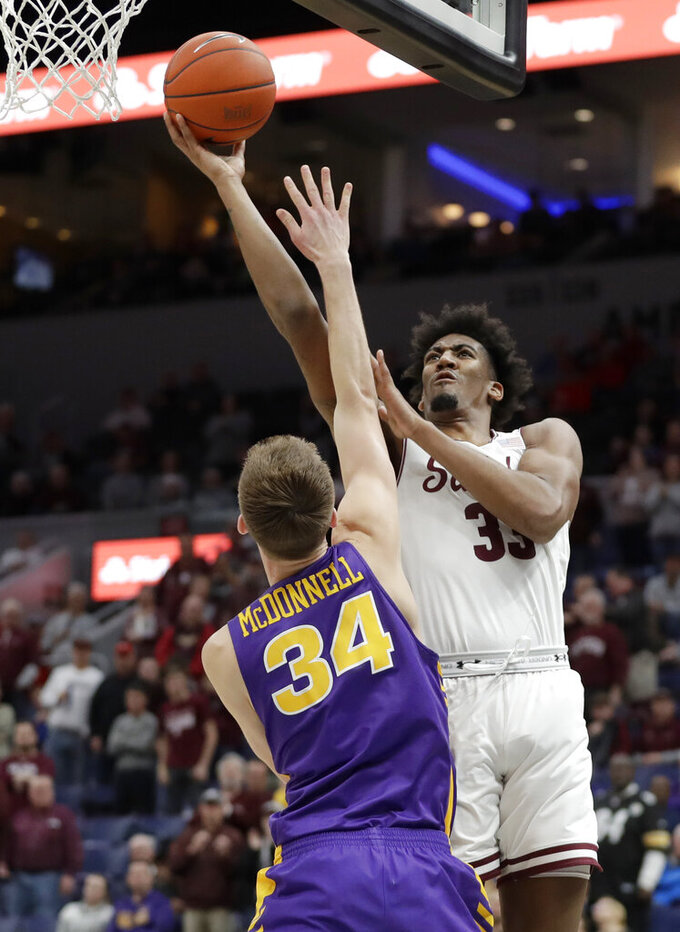 Southern Illinois' Kavion Pippen heads to the basket past Northern Iowa's Luke McDonnell (34) during the first half of an NCAA college basketball game in the quarterfinal round of the Missouri Valley Conference tournament, Friday, March 8, 2019, in St. Louis. (AP Photo/Jeff Roberson)