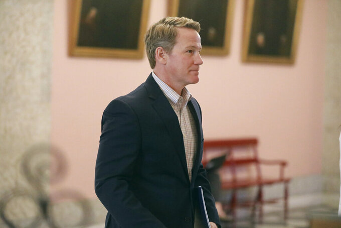 "FILE-This Monday, March 23, 2020 file photo shows Ohio Lt. Gov. Jon Husted walking out of a coronavirus news conference at the Ohio Statehouse in Columbus, Ohio. Husted is continuing to face criticism for a recent tweet where he referred to COVID-19 as the ""Wuhan virus,"" as advocates warn the phrase is leading to an uptick of violence against Asian Americans. (Doral Chenoweth/The Columbus Dispatch via AP, File)"