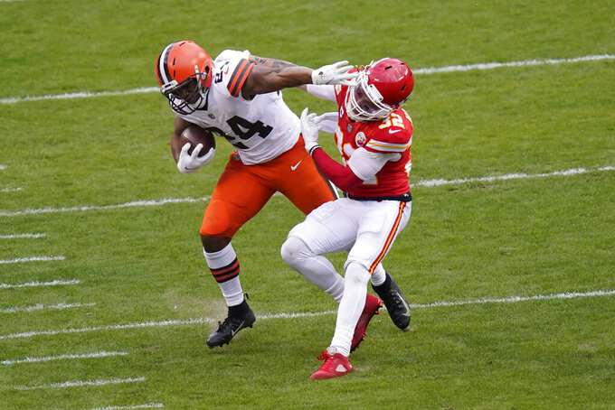 Cleveland Browns running back Nick Chubb (24) is tackled by Kansas City Chiefs safety Tyrann Mathieu (32) during the second half of an NFL divisional round football game, Sunday, Jan. 17, 2021, in Kansas City. (AP Photo/Orlin Wagner)