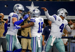 Dallas Cowboys' Jason Witten (82), Randall Cobb (18) and Dak Prescott (4) celebrate a touchdown catch by Witten in the first half of a NFL football game against the New York Giants in Arlington, Texas, Sunday, Sept. 8, 2019. (AP Photo/Michael Ainsworth)