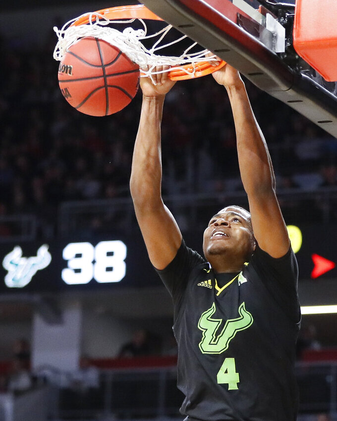 South Florida's Michael Durr dunks in the second half of the team's NCAA college basketball game against Cincinnati, Tuesday, Jan. 15, 2019, in Cincinnati. (AP Photo/John Minchillo)