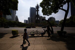 "The street and pedestrian area around the Angel of Independence monument are almost empty in Mexico City, Tuesday, June 2, 2020, amid the new coronavirus pandemic. While the federal government's nationwide social distancing rule formally ended Monday, it is urging people in so-called ""red"" zones to maintain most of those measures — and so many people are falling ill and dying each day that those zones cover nearly the whole country. (AP Photo/Fernando Llano)"
