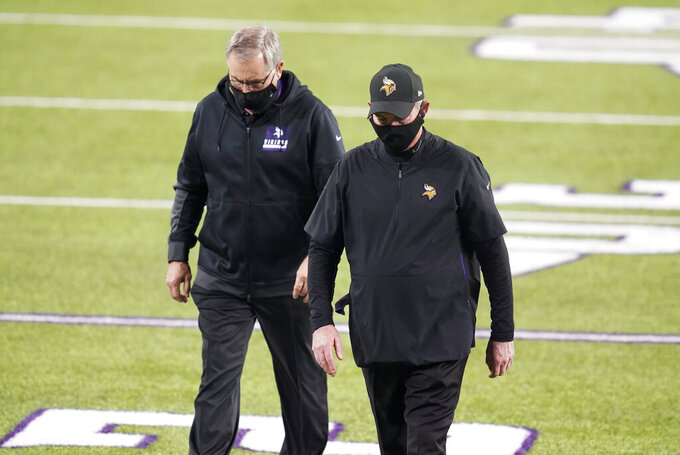 Minnesota Vikings head coach Mike Zimmer, right, walks off the field after an NFL football game against the Dallas Cowboys, Sunday, Nov. 22, 2020, in Minneapolis. The Cowboys won 31-28. (AP Photo/Jim Mone)