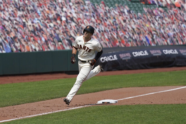 San Francisco Giants' Mike Yastrzemski rounds the bases on his solo home run against the Arizona Diamondbacks during the sixth inning of a baseball game in San Francisco, Sunday, Aug. 23, 2020. (AP Photo/Jeff Chiu)