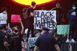 Protesters rally Friday, May 29, 2020, in the Brooklyn borough of New York. at the Barclays Center over the death of George Floyd, a black man who was in police custody in Minneapolis. Floyd died after being restrained by Minneapolis police officers on Memorial Day. (AP Photo/Frank Franklin II)