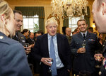 Britain's Prime Minister Boris Johnson, center, speaks to guests at a military reception held at 10 Downing Street, London, Wednesday, Sept. 18, 2019. Johnson was accused by European Union officials Wednesday of failing to negotiate seriously and branded the