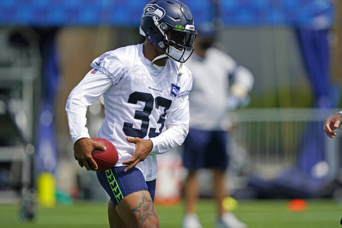 Seattle Seahawks safety Jamal Adams holds the football during a practice drill at NFL football training camp, Wednesday, Aug. 12, 2020, in Renton, Wash. (AP Photo/Ted S. Warren, Pool)