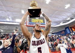 FILE - in this March 10, 2020, file photo, Robert Morris guard A.J. Bramah hoists the trophy after Robert Morris defeated St. Francis in an NCAA college basketball game for the Northeast Conference men's tournament title, in Pittsburgh. Robert Morris is leaving the Northeast Conference to join the Horizon League. The school announced on Monday, June 15, 2020, that it will become the 12th member of the Horizon League on July 1. (Matt Freed/Pittsburgh Post-Gazette via AP, File)