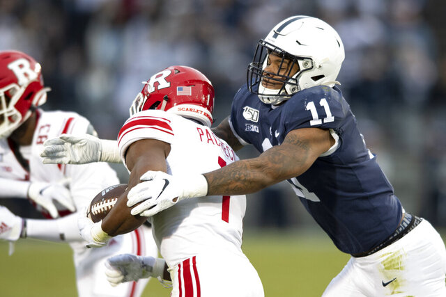 FILE - In this Nov. 30, 2019, file photo, Penn State linebacker Micah Parsons (11) tackles Rutgers tight end Johnathan Lewis (11) in the first quarter of an NCAA college football game, in State College, Pa. Parsons was selected to The Associated Press preseason All-America first-team, Tuesday, Aug. 25, 2020. Parsons and Oregon tackle Penei Sewell are among 11 players selected who are not slated to play this fall. (AP Photo/Barry Reeger, File)