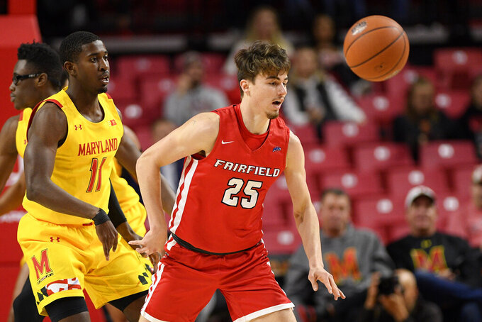 Fairfield guard Landon Taliaferro (25) and Maryland guard Darryl Morsell (11) chase the loose ball during the first half of an NCAA college basketball game, Tuesday, Nov. 19, 2019, in College Park, Md. (AP Photo/Nick Wass)