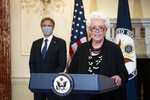 Gayle Smith, the new State Department Coordinator for Global COVID-19 Response and Health Security, speaks about U.S. leadership in fighting the coronavirus pandemic at the State Department in Washington, Monday, April 5, 2021, as Secretary of State Antony Blinken listens. (Al Drago/Pool via AP)