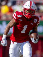 Nebraska wide receiver Wan'Dale Robinson (1) scores a touchdown during an NCAA college football game against Northwestern, Saturday, Oct. 5, 2019 in Lincoln, Neb. (Emily Haney/Lincoln Journal Star via AP)
