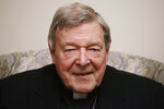 Cardinal George Pell poses for a picture during an interview with the Associated Press inside his residence near the Vatican in Rome, Monday, Nov. 30, 2020. The pope's former treasurer, who was convicted and then acquitted of sexual abuse in his native Australia, said Monday he feels a dismayed sense of vindication as the financial mismanagement he tried to uncover in the Holy See is now being exposed in a spiraling Vatican corruption investigation. (AP Photo/Gregorio Borgia)