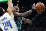 Boston Celtics' Terry Rozier (12) shoots against Orlando Magic's Khem Birch (24) during the first half of an NBA basketball game in Boston, Sunday, April 7, 2019. (AP Photo/Michael Dwyer)