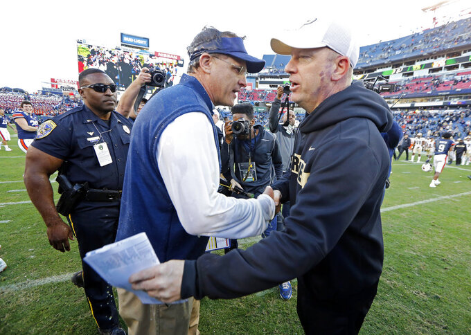 Purdue head coach Jeff Brohm, right, congratulates Auburn head coach Gus Malzahn after the Music City Bowl NCAA college football game Friday, Dec. 28, 2018, in Nashville, Tenn. (AP Photo/Mark Humphrey)