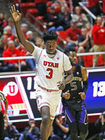 Utah forward Donnie Tillman (3) celebrates after scoring a 3-pointer on Washington guard Jaylen Nowell (5) during the first half of an NCAA college basketball game Thursday, Jan., 10, 2019, in Salt Lake City. (AP Photo/Rick Bowmer)