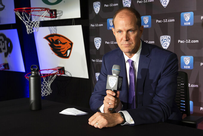 Washington head coach Mike Hopkins speaks during the Pac-12 NCAA college basketball media day, in San Francisco, Tuesday, Oct. 8, 2019. (AP Photo/D. Ross Cameron)
